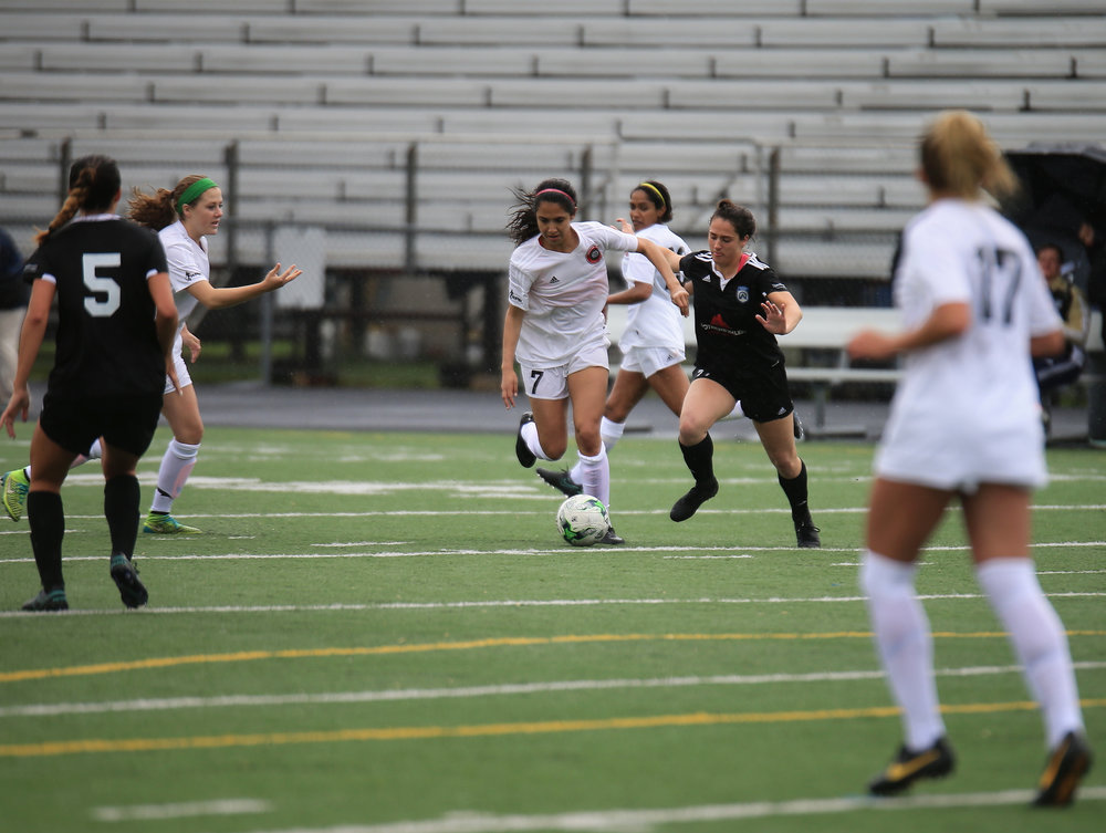 Christina Murillo (No.7) playing defense for Motor City FC against Cleveland at Hurley Field.