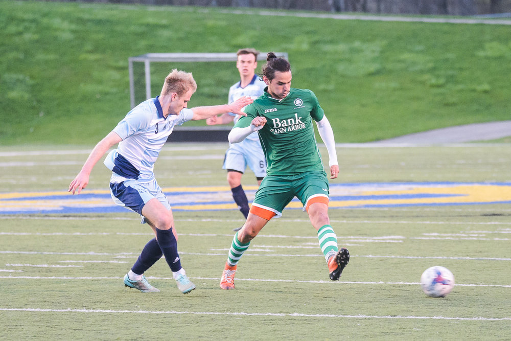 Hector Morales looks to advance past a Northwood University defender