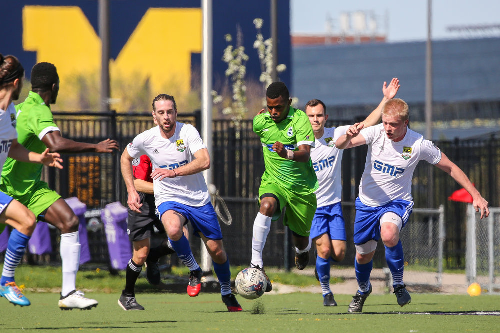 Jesse Muskwe presses forward in Sunday's 2-0 win in The Mighty Oak's home opener friendly