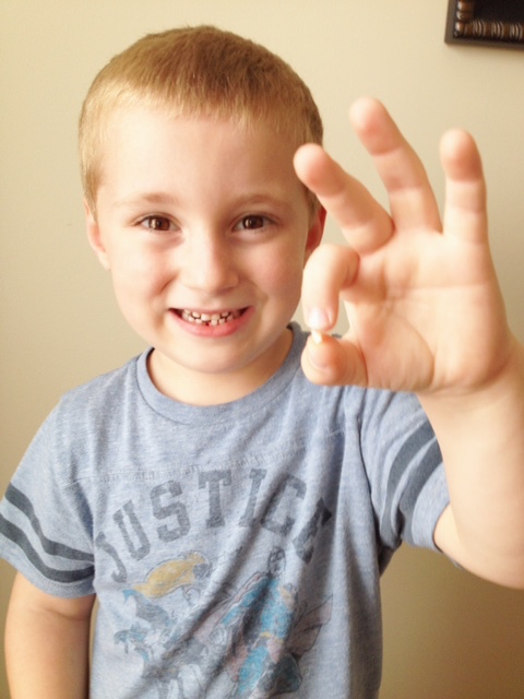 Landon's first tooth