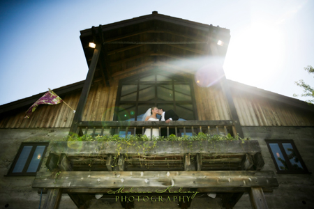 bride and groom on the balcony at wente vineyards' murietta well