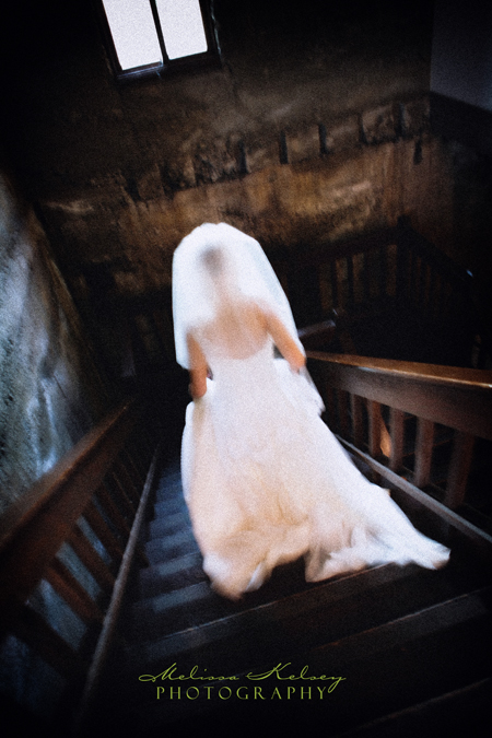 bride descending stairs at her wente vineyards wedding