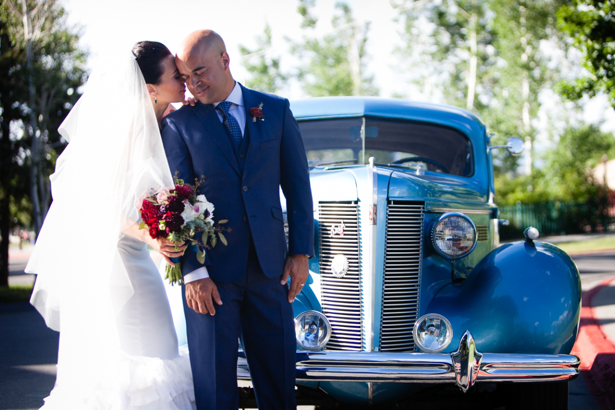 bride and groom with vintage car in park city utah