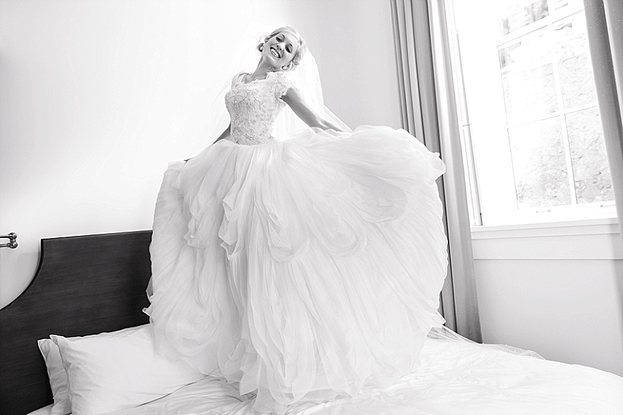 bride jumping on bed washington schoolhouse hotel