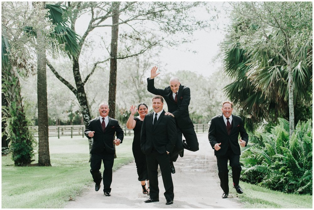 Leave it to the groom's party to have a photo like this! Don't you just love how much fun they are having?