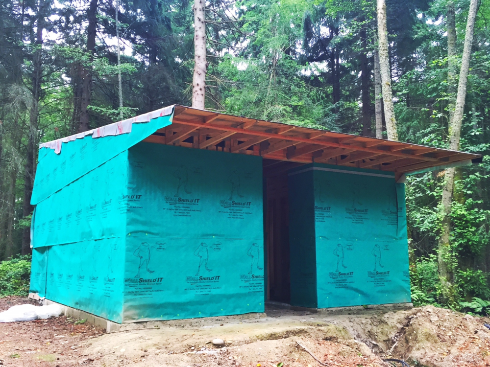 The exterior of the studio, with its 'frogskin' to protect it from the weather until the siding goes on.