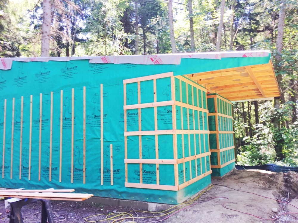 most recent shot of the exterior, with rain screen, which creates 'air' between the inner and outer exterior walls, being applied.