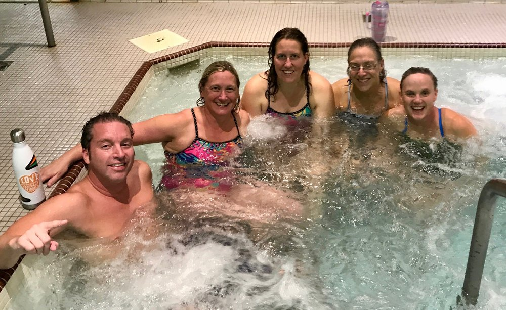Nic Ohman, Karin Stokes, Kysa Crusco, Beth Estel, and Sue Jensen enjoyed the hot tub after the meet