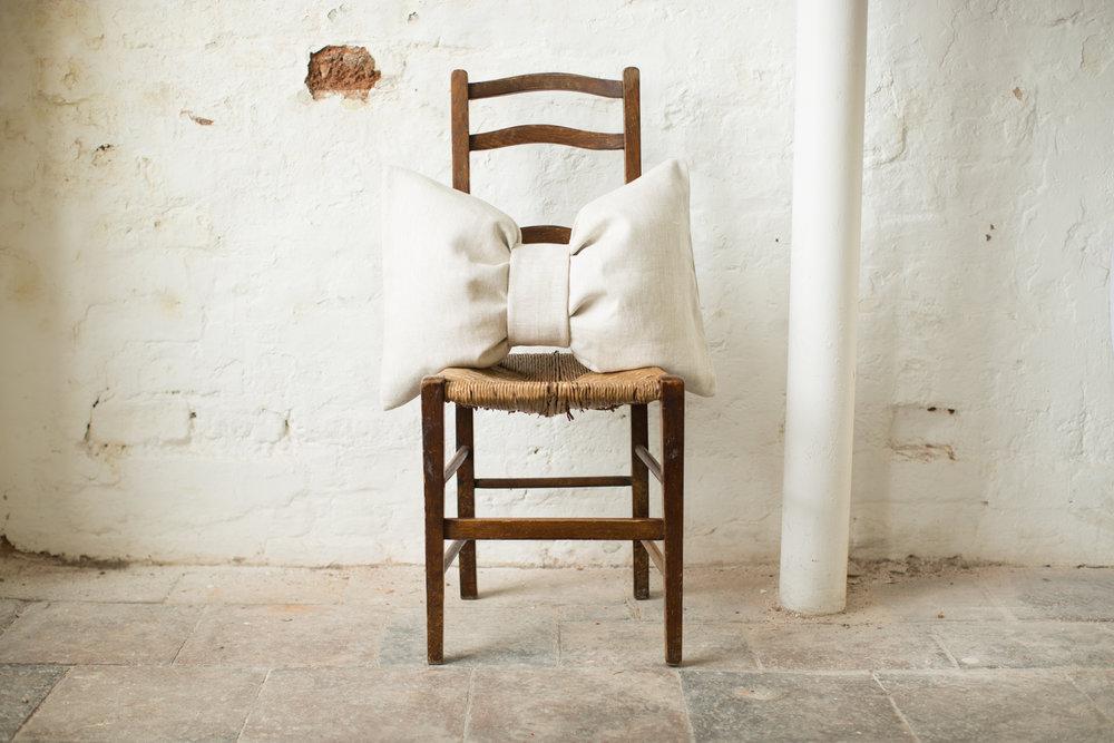 Katie Larmour Design, Luxury Irish Linen Brand, Award winning signature 'Bow' cushion photographed at Conway Mill Belfast.jpg