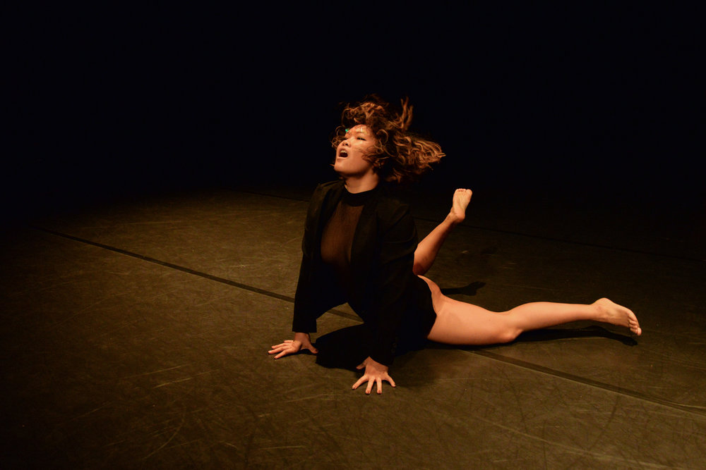 Belinda Adam in backbend on stomach, photo by Jessica Schmitt. Photo from the 11th Annual REVERBDance Festival.
