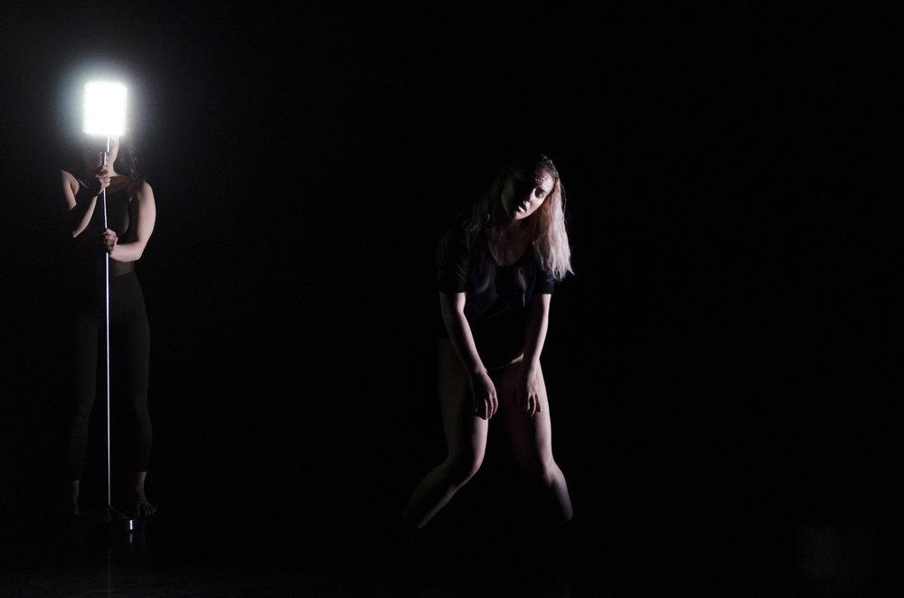 Alexandra Wood in shadow from light, photo by Umi Akiyoshi. Photo from Spline.
