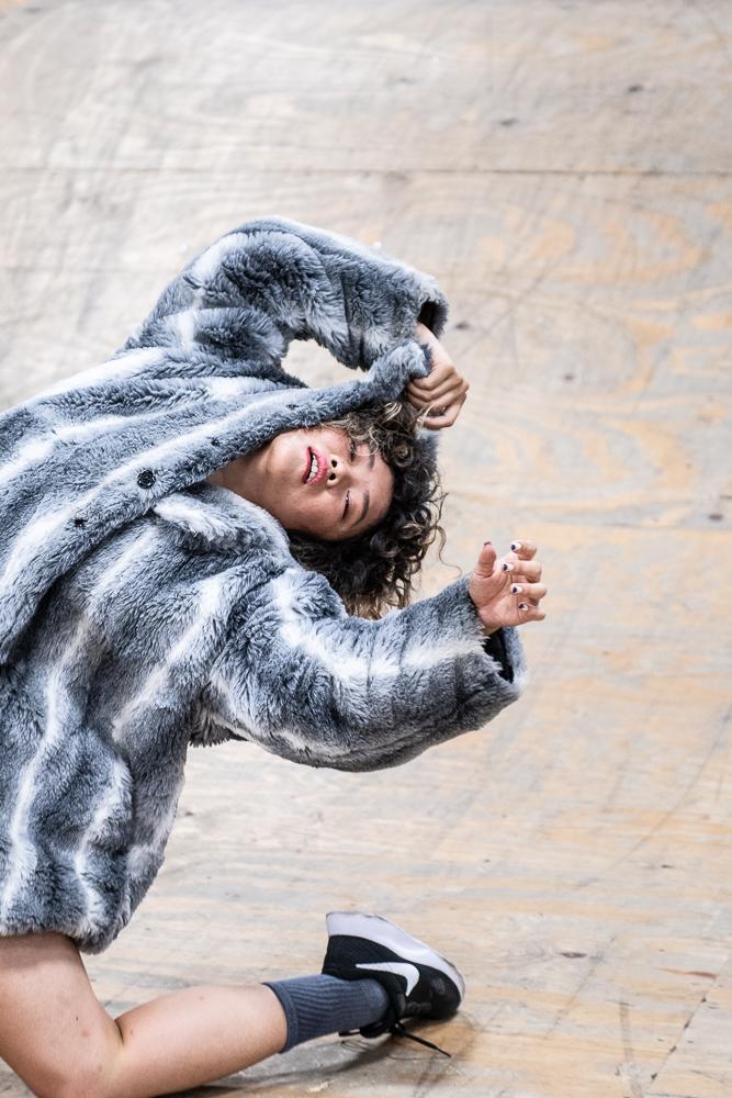 Belinda Adam hinging back in fur coat, photo by Umi Akiyoshi.