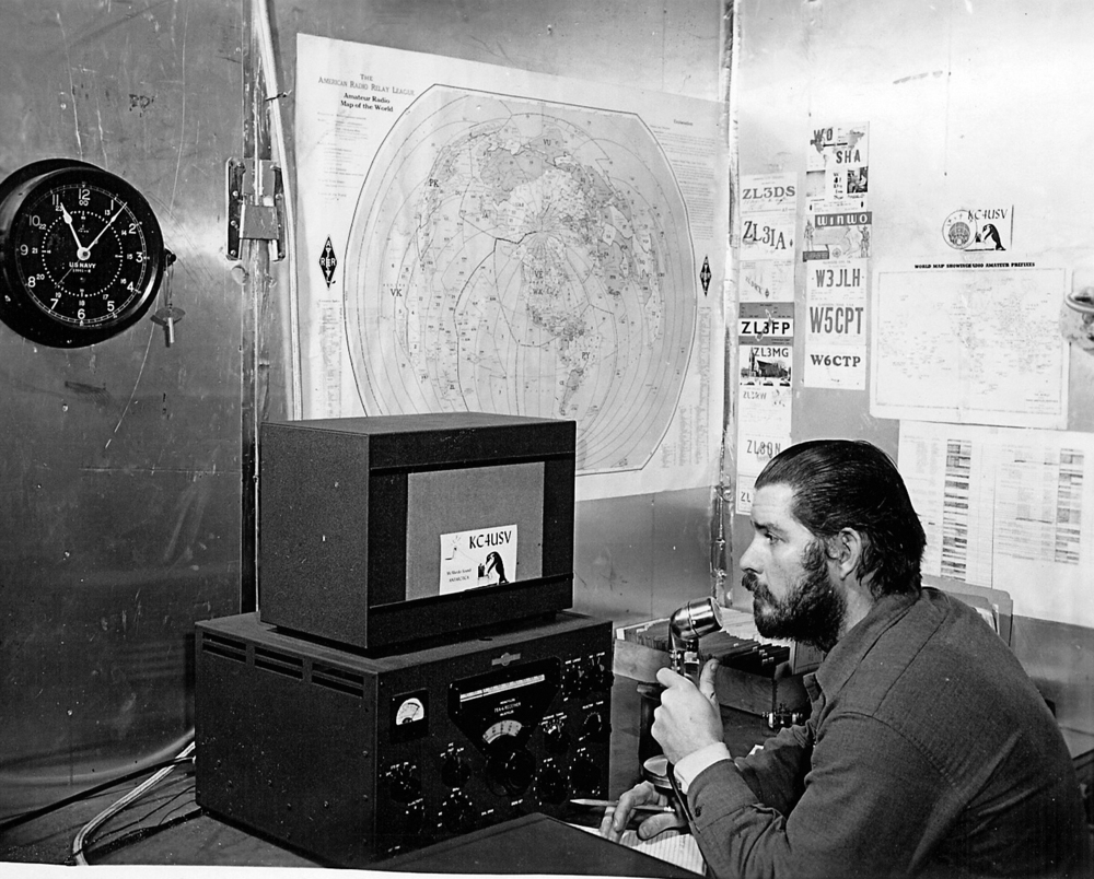 U.S. Navy Chief Petty Officer Adrey Garret uses a ham radio at Williams Air Operating Facility during the 1956 winter. Ham radio was the only means of voice communication with friends and family back in the U.S. for navy personnel living and working in Antarctica. (Public Domain Photo)