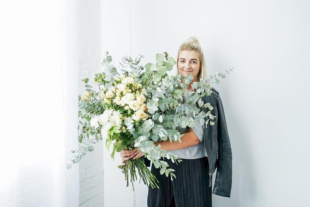 blonde girl with bunch of flowers