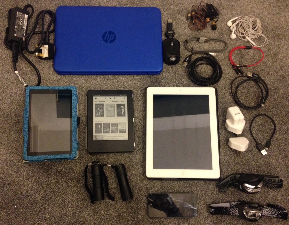 Electronics: travel laptop with mini mouse, a kindle each, iPad, 2 iPhones, 4 pairs of headphones and headphone splitter, 4 x chargers, 2 torches, 2 head torches.