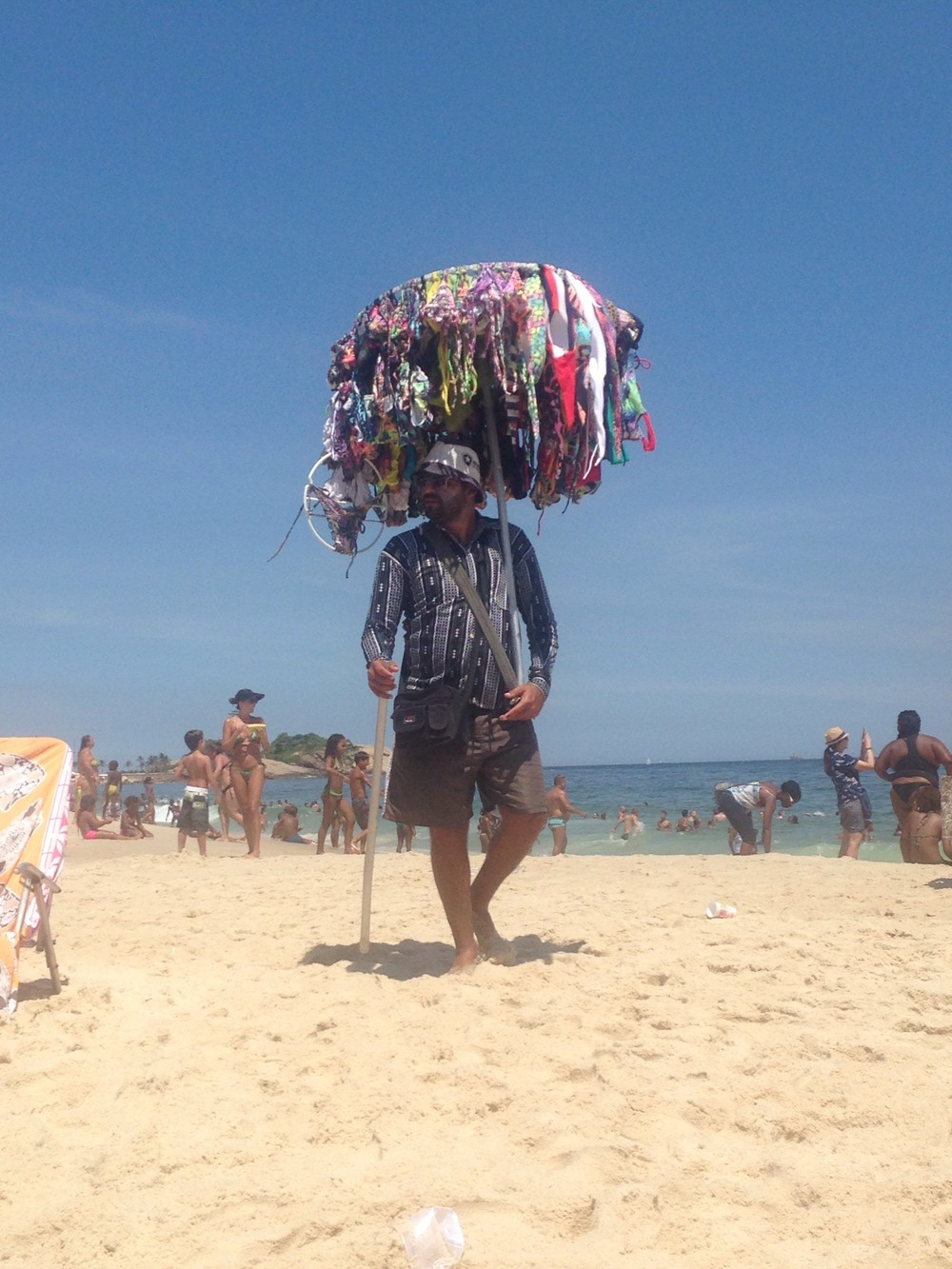 Bikini seller on Copacabana beach, that's an umbrella!