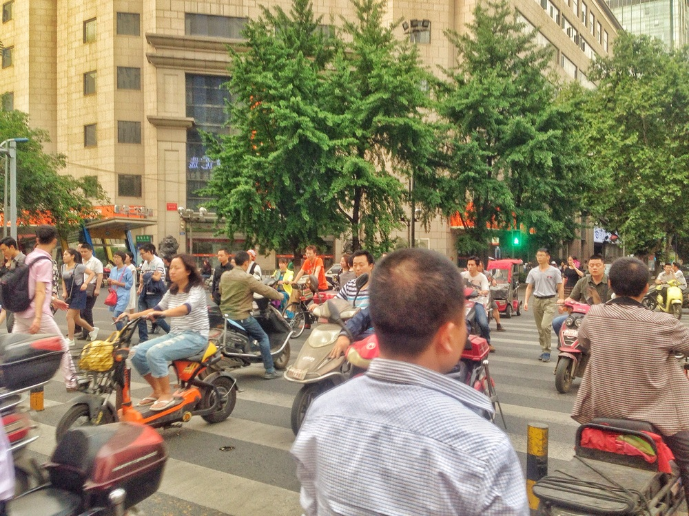 Chaos; pedestrians and mopeds go!