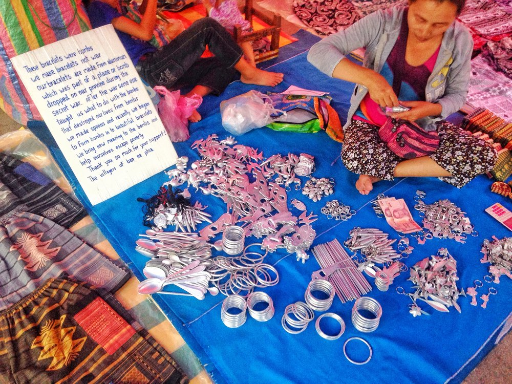 Tourist souvenirs made from bombs being sold in Luang Prabang market.