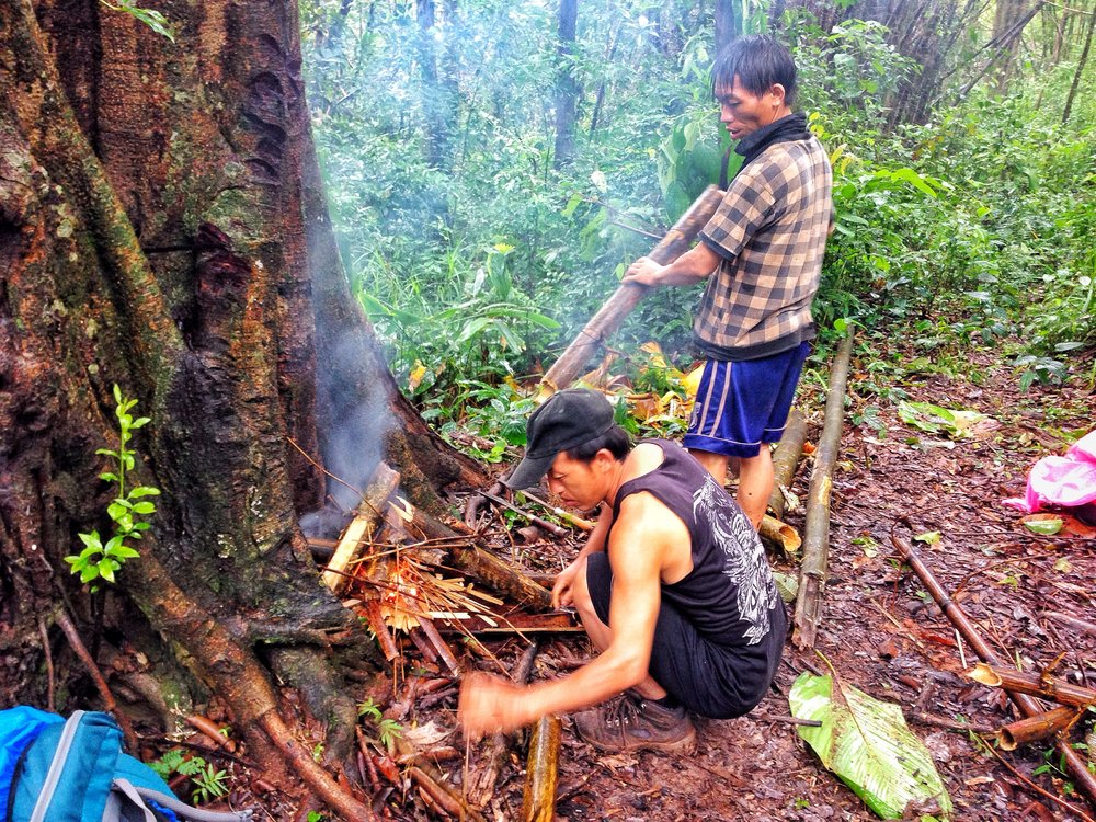 Building a fire in the Luang Namtha jungle.