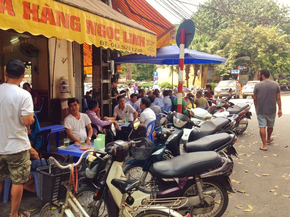 Street restaurants and pavement parking in Hanoi
