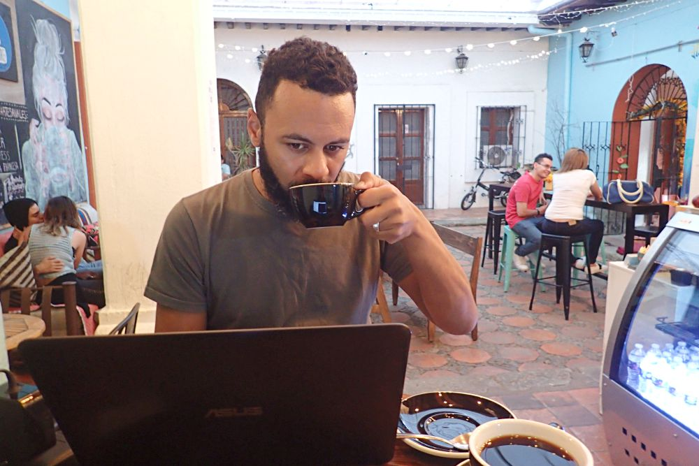Travel blogger working in cafe