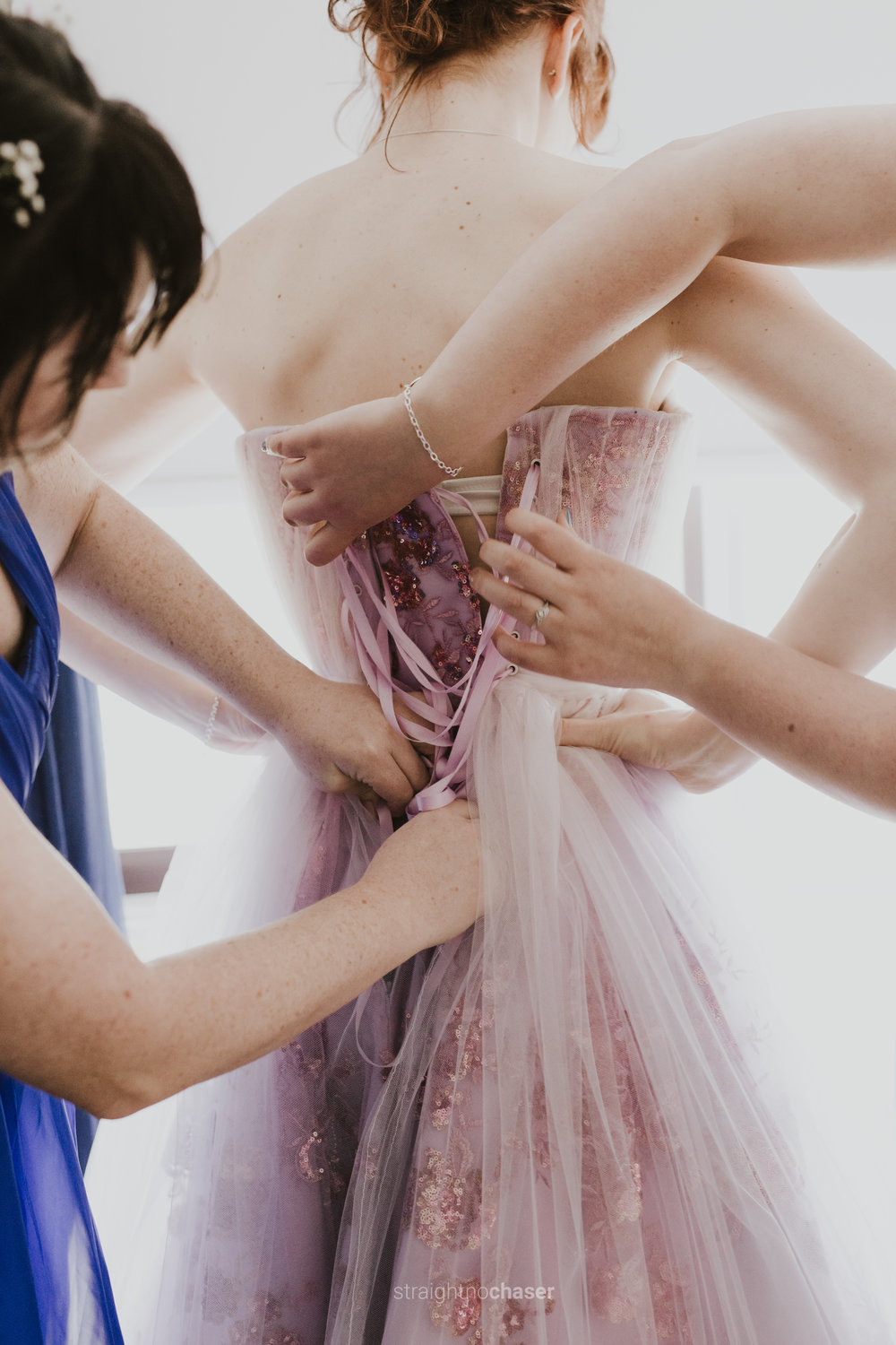 Mauve pink wedding dress - getting ready.  Photography by Straight No Chaser