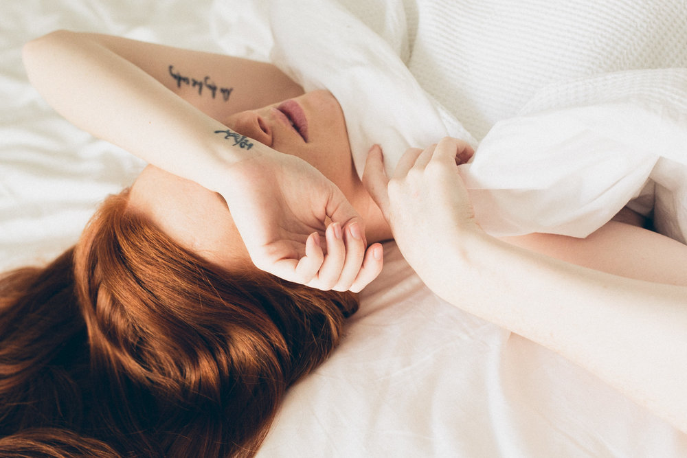 Red hair white sheets in bed shoot by Jenny Wu Canberra