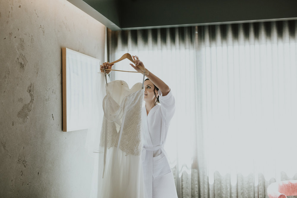 Jack Sullivan Bridal Sian wedding dress/ Bride getting ready at Hotel Hotel Canberra, NGA wedding, photography by Jenny Wu