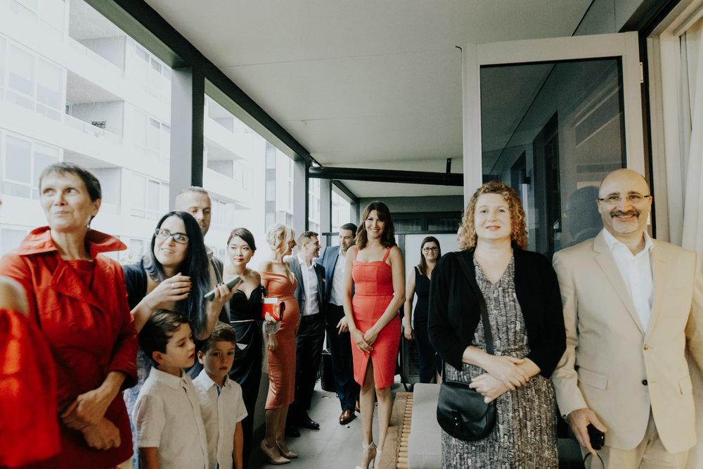 Intimate balcony wedding Canberra - wet weather ceremony- photography by Jenny Wu