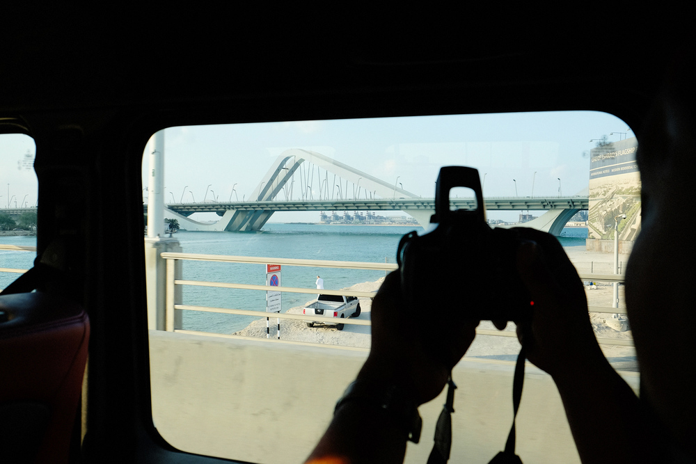 Albert snapping away as we are passing by the quirky Sheikh Zayed Bridge