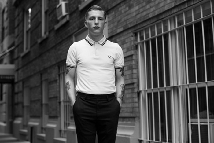 A model wearing a Fred Perry polo shirt in the mod style.