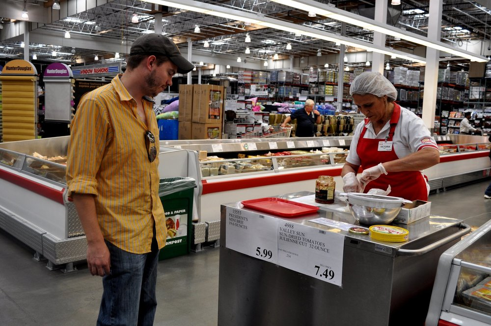 A Costco sample server stands at her workstation.   courtesy: popsugar