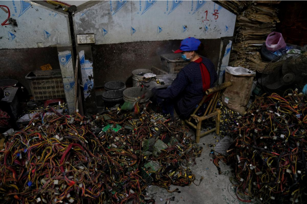 A worker dismantles electronic waste at the government-sponsored recycling park in the township of Guiyu, Guangdong Province, China January 12, 2018. Picture taken January 12, 2018.  Courtesy:REUTERS/Aly Song