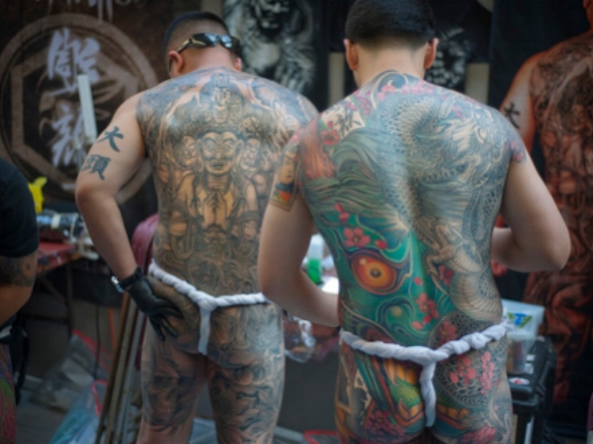 british amateur back tattoo