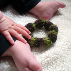 A little crocheted something for the baby to chew. Came together in two short sessions.