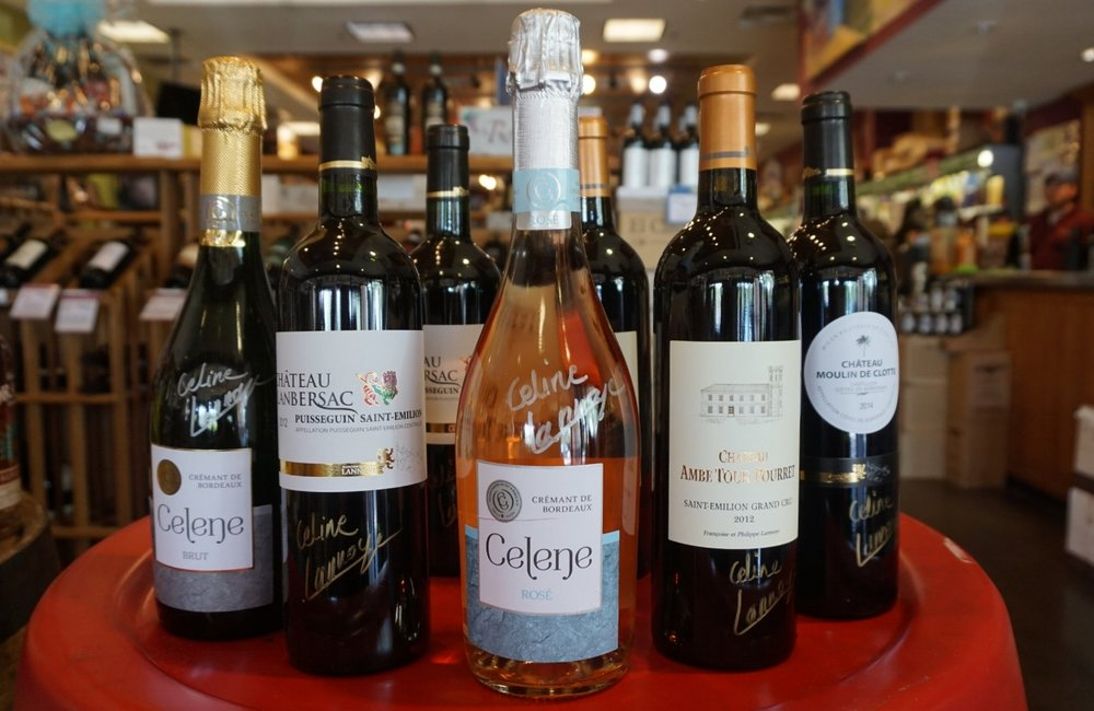(above) Celene Rose surrounded by other Lannoye family wines, all sporting Celine's signature.