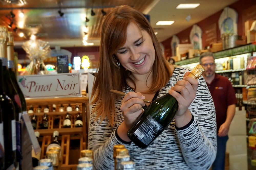 (above) Celine graciously putting up with my paparazzi moves and signing some of her bottles for our customers!