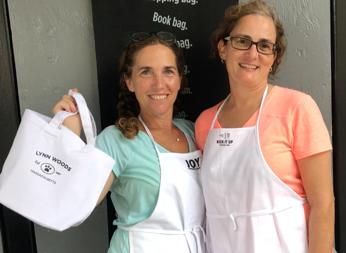 Launch Event - Carla & Karen working on merch!