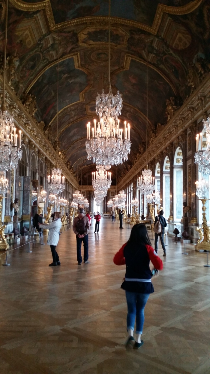 Inside, the chateau was as opulent as expected, with elaborate rooms and carpeted walls and paintings of the royal family everywhere.