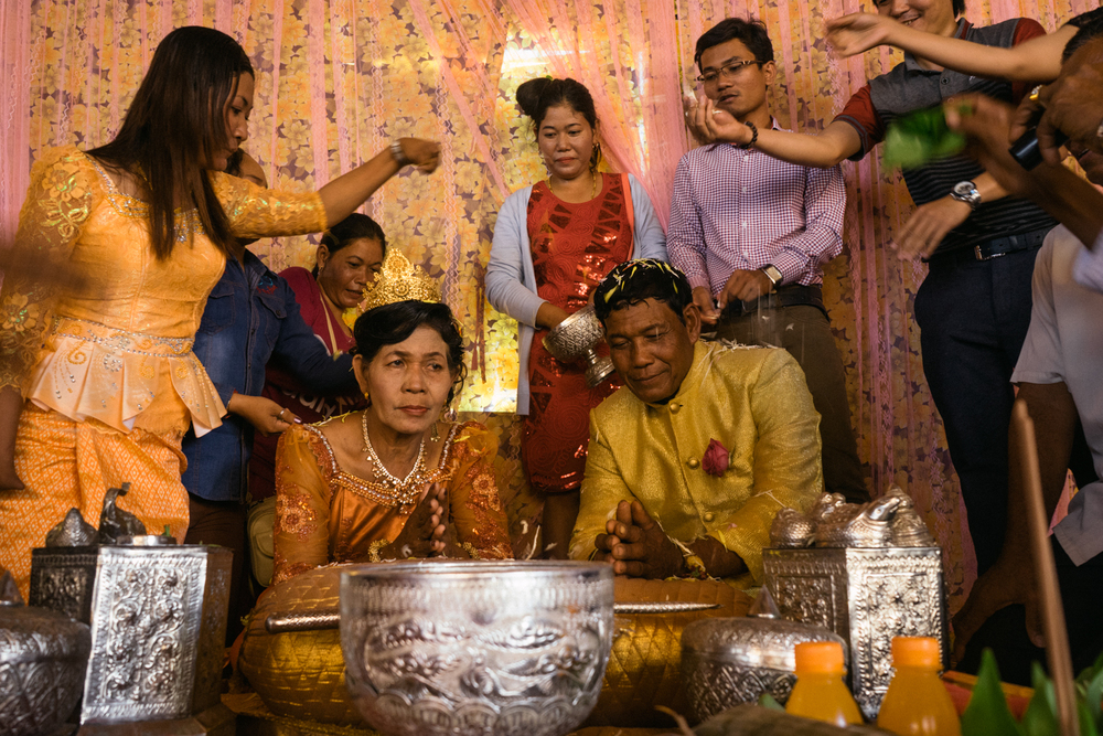 Morb Heang and Nou Sout at their wedding ceremony which was held for victims of forced marriages by the Khmer Rouge. Several couples have decided to have a formal wedding ceremony almost four decades after their forced marriage, a crime which is today being tried as a crime against humanity by a war crimes tribunal.