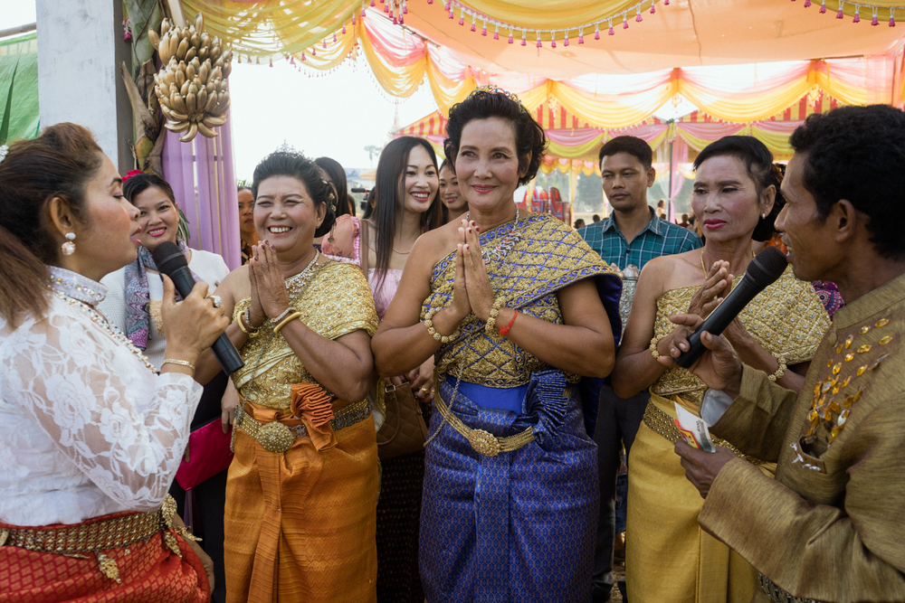 Brides participate during a fruit parade at a Cambodian wedding ceremony held for victims of forced marriages by the Khmer Rouge. Several couples have decided to have a formal wedding ceremony almost four decades after their forced marriage, a crime which is today being tried as a crime against humanity by a war crimes tribunal.
