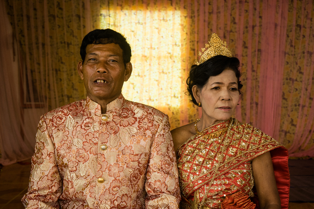 Morb Heang (left) and Nou Sout pose for a photo at a ceremony held for victims of forced marriages by the Khmer Rouge. Several couples in one commune have decided to have a formal wedding ceremony almost four decades after their forced marriage, a crime which is today being tried as a crime against humanity by a war crimes tribunal.