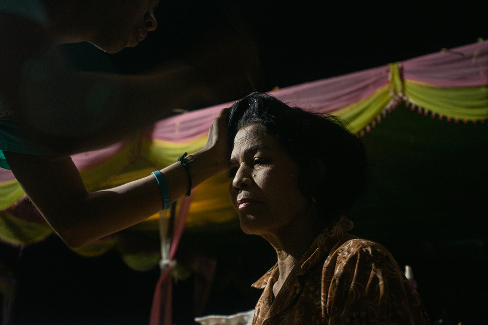 Nou Sout gets ready for her wedding - a ceremony held for victims of forced marriages by the Khmer Rouge. Several couples have decided to have a formal wedding ceremony almost four decades after their forced marriage, a crime which is today being tried as a crime against humanity by a war crimes tribunal.