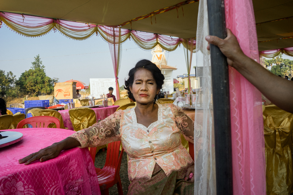 A Cambodian bride rests during a wedding ceremony held for victims of forced marriages by the Khmer Rouge. Several couples have decided to have a formal wedding ceremony almost four decades after their forced marriage, a crime which is today being tried as a crime against humanity by a war crimes tribunal.