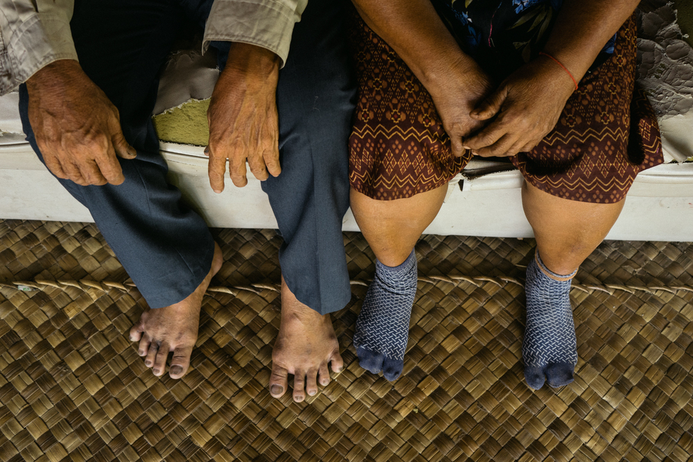 A close up of the hands of Groom Sok Hort and bride Yim Ran in their home a day before their wedding ceremony, held for victims of forced marriages by the Khmer Rouge. Several couples have decided to have a formal wedding ceremony almost four decades after their forced marriage, a crime which is today being tried as a crime against humanity by a war crimes tribunal.