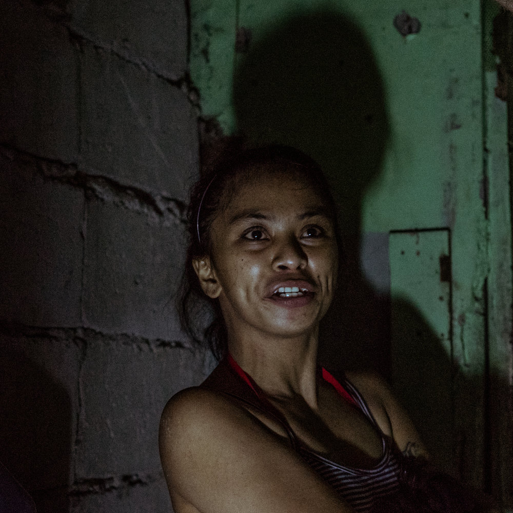 Shirlyn, the wife of a victim of the war on drugs, is seen in her home where husband died. Four men came to their home and gunned her husband down while he was in the bathroom.