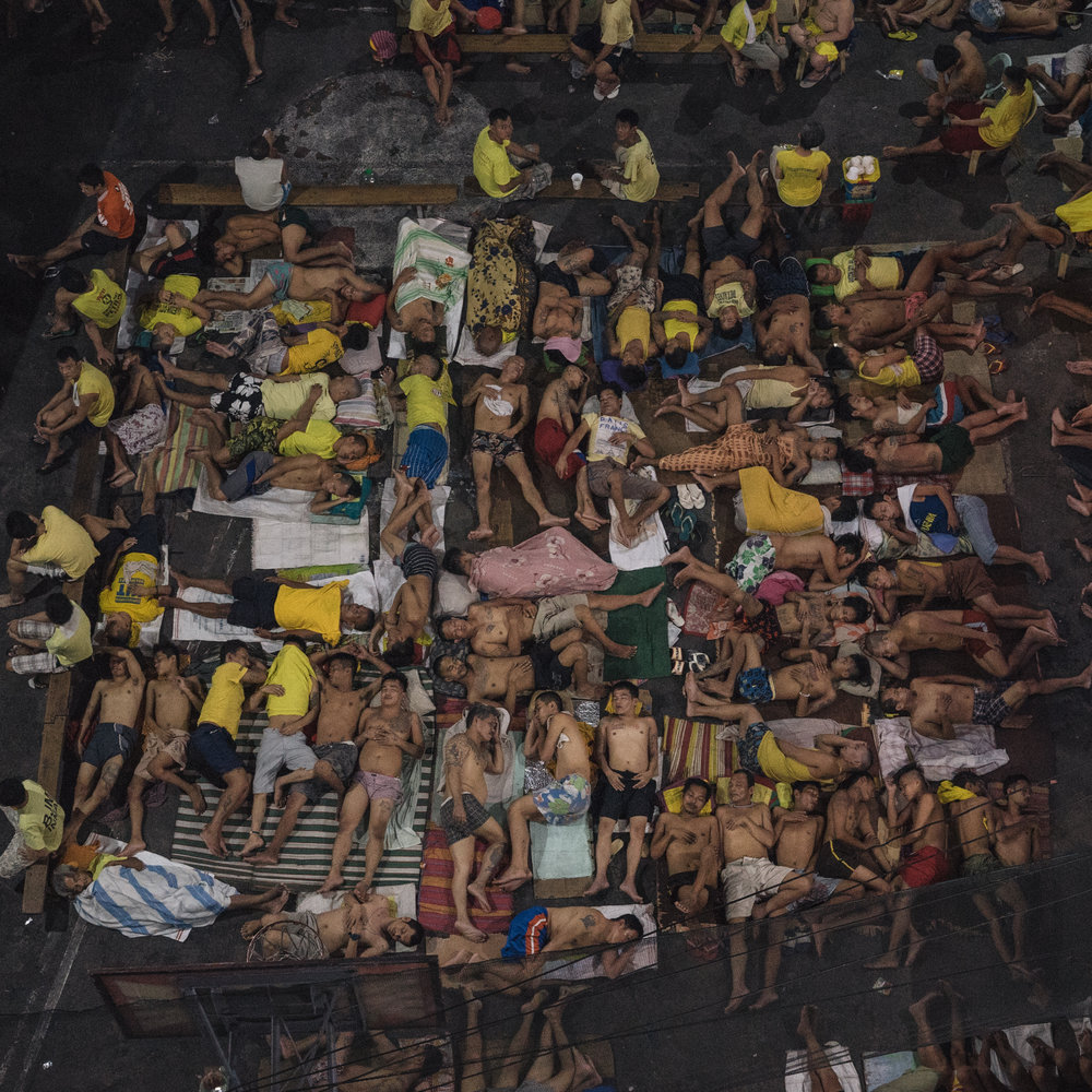 Men are seen sleeping iside a crowded jail in Manila, Philippines. As more men are arrested for drug use, jails become congested, and friends and families of inmates report men refusing to walk free in fear of being killed by the police.