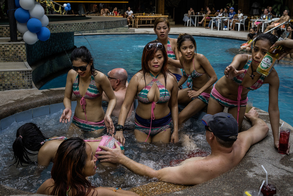 Women in Angeles city, notorious for its red light district and its sex tourism industry, entertain foreign clients during the daytime.