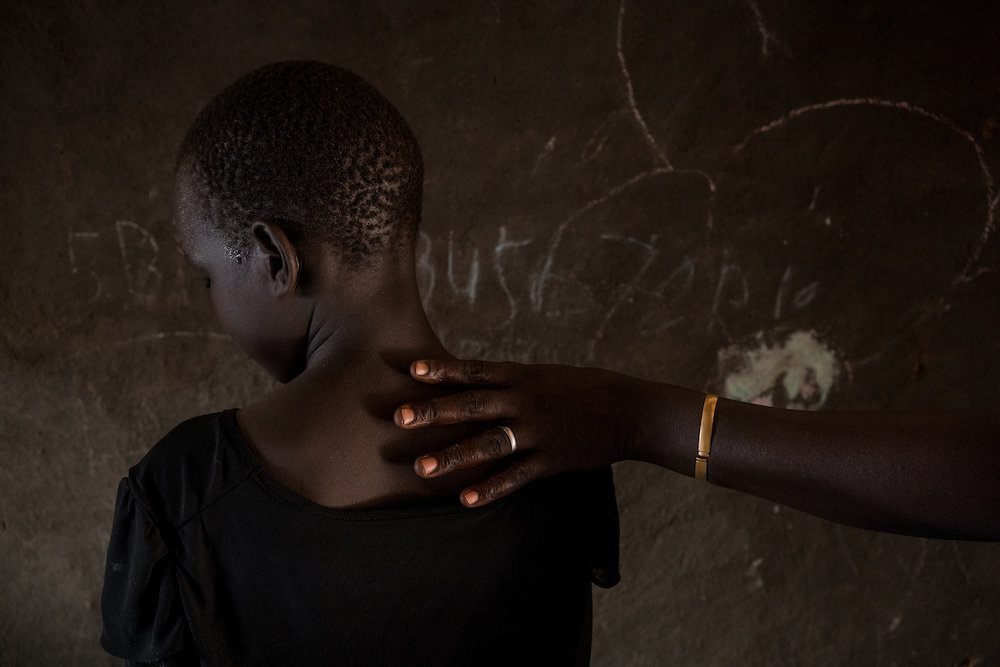 A young girl, who witnessed her mother being raped when they were collecting firewood, is seen in her home in a POC site in South Sudan. In South Sudan, women and girls displaced from war must leave protection of civilians sites to collect firewood - a task traditionally done by women, who make up majority of the population in these camps. The journey is perilous and puts these women at continued risk of sexual violence, which rights groups have called an 'epidemic' in the country.