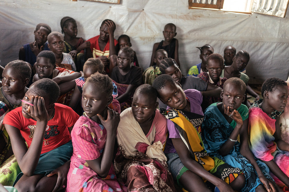 Girls are seen in a center for girls inside a Protection of Civilians (POC) site in Juba. In this space for young girls, counselors help the girls become more independent - among the things they learn is what to do in case a man rapes or tries to rape you when you collect firewood.